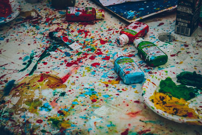 paint splattered on the floor and painting supplies strewn everywhere